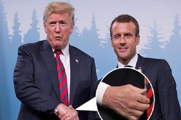 Tay Trump hằn vết sau cú bắt tay với Tổng thống Pháp
