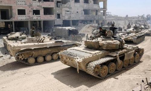Quân chính phủ Syria tại khu vực Đông Ghouta hồi tháng 4/2018. Ảnh: AFP.