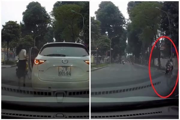 Nữ tài xế nhặt mũ bảo hiểm rơi giúp người đàn ông chạy xe máy