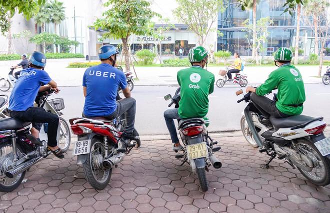 Thuong vu Grab mua Uber co dau hieu vi pham phap luat hinh anh 1