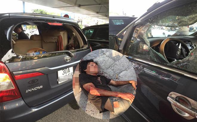 Người đàn ông đập phá ô tô.