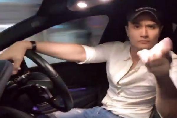Vĩnh Thụy bị chỉ trích vì bỏ hai tay nhún nhảy khi đang lái xe